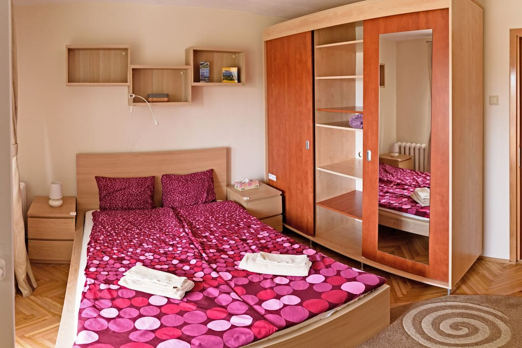 Your spacious bedroom next to the bathroom
