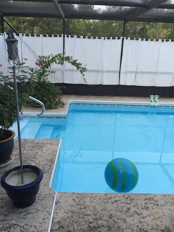 The sparkling backyard playground-32 feet, with two iron mermaid lifeguards (Swimmable May - Oct)