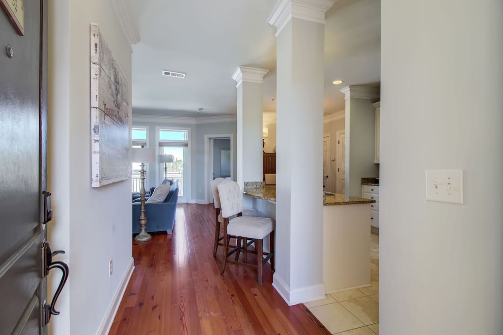 As you walk in - first glance at gleaming hardwood floors and bright/airy floorplan