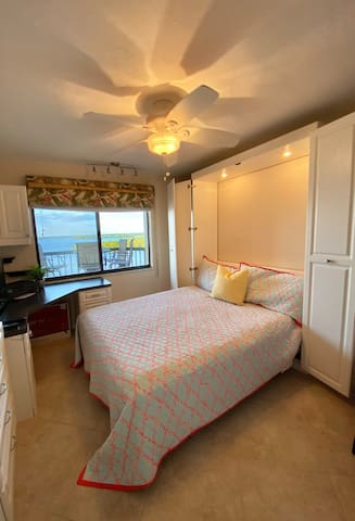 Guest bedroom with Murphy Bed and another desk area with a view of the Bay.