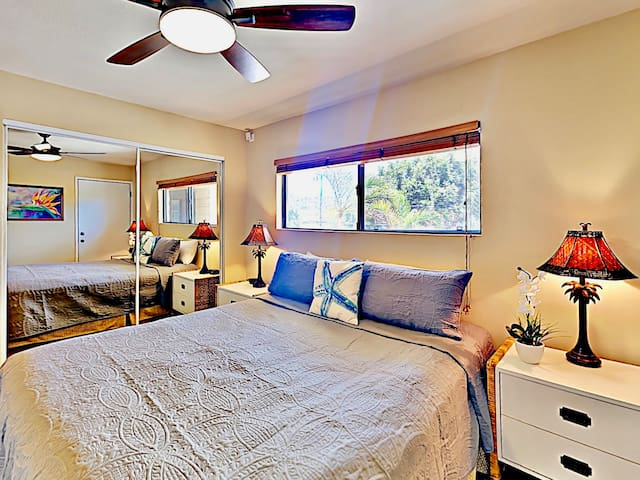 Serene setting in your bedroom with warm, calming hues and breezy ceiling fan.