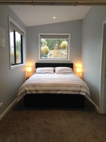 Queen bed with mountain outlook