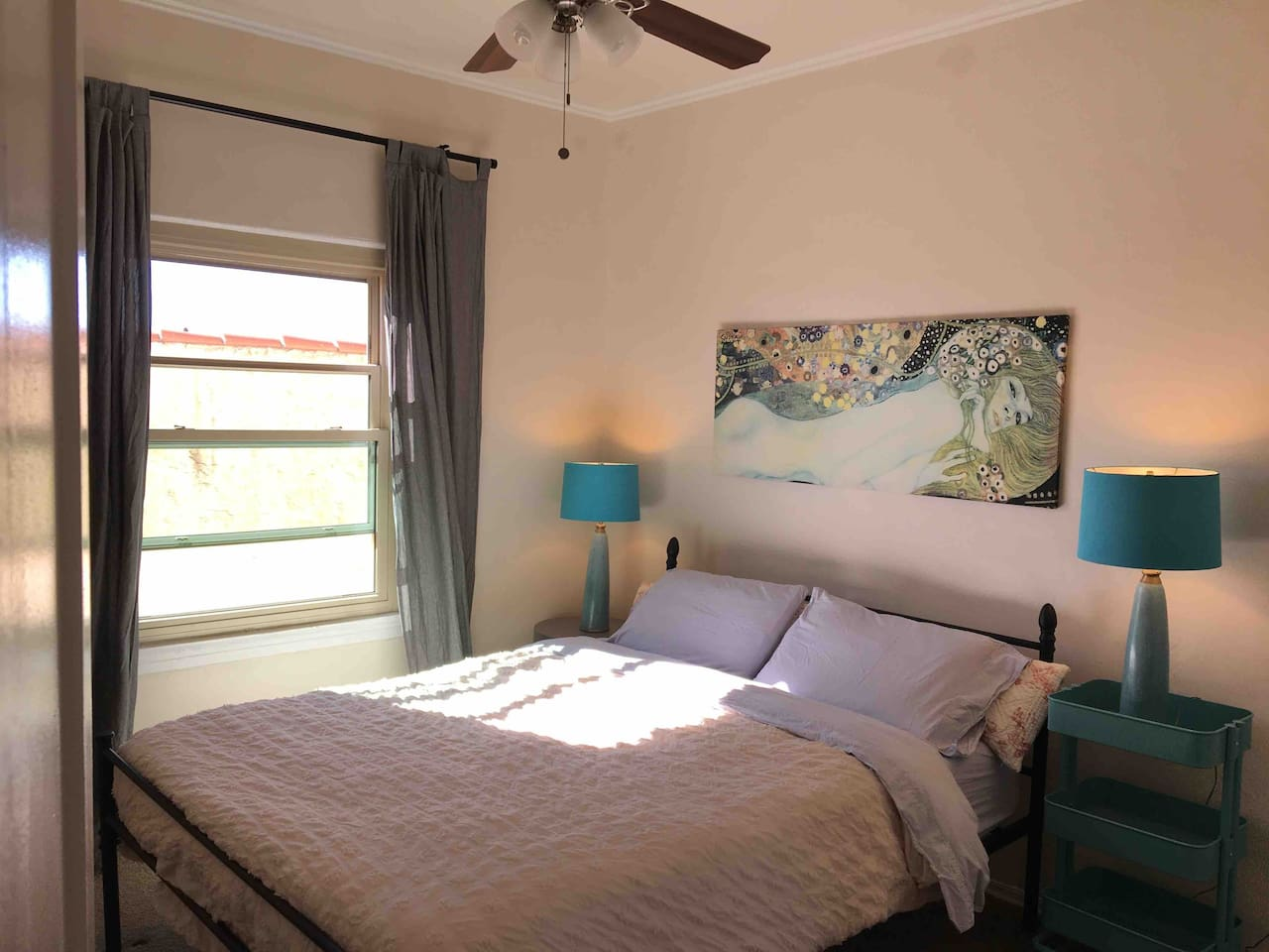 Your quiet and sunny guest room with queen bed, 100% organic cotton sheets and foam mattress