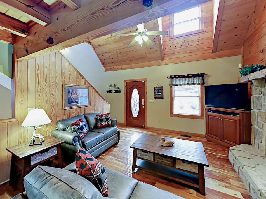 """The living area has a queen-size sleeper sofa, 47"""" flat screen TV, and gas fireplace. Complimentary Wi-Fi is provided."""
