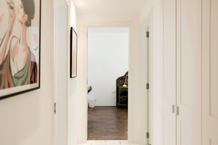 The corridor leading to the apartment's three bedrooms.