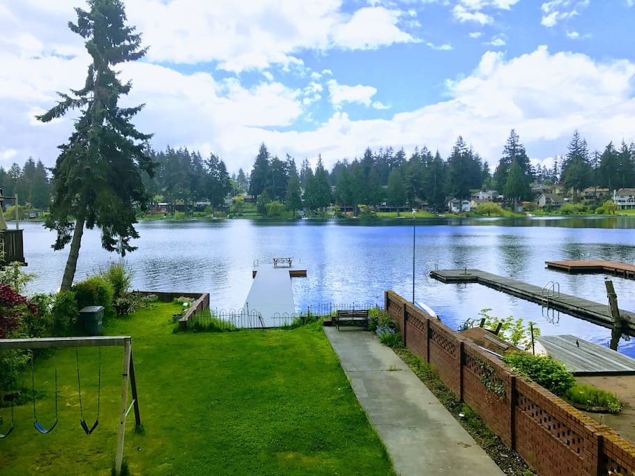 This is your view from the private patio overlooking the lake.  You just need to take side stairs to go down to the backyard and lake/dock area.
