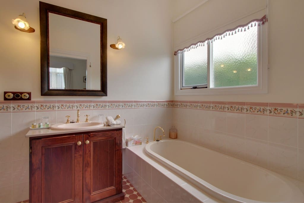 Large ensuite with separate bath and shower