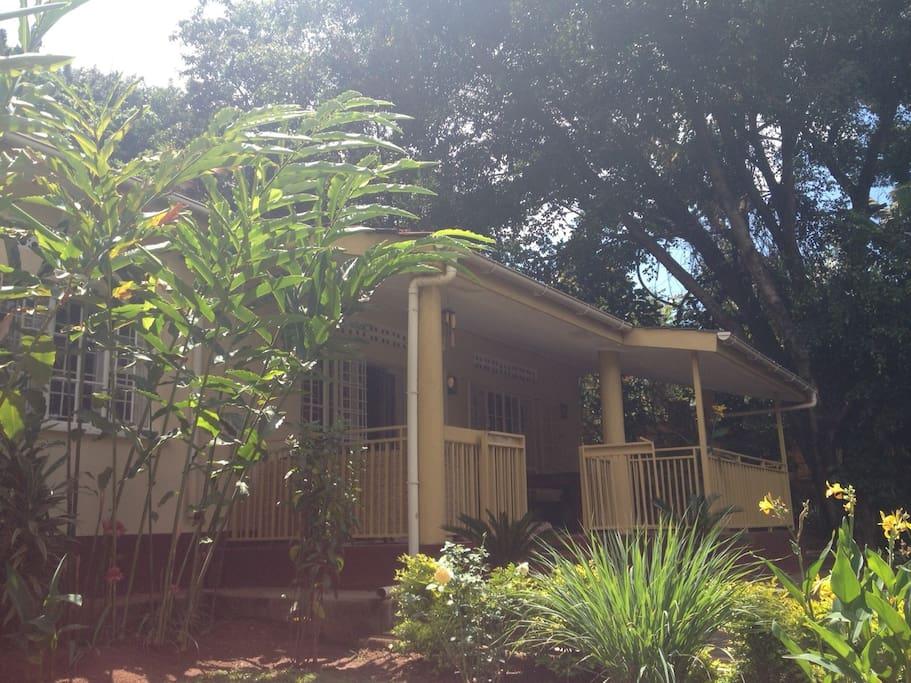Beautiful, serene house with large veranda in the lush, green garden.