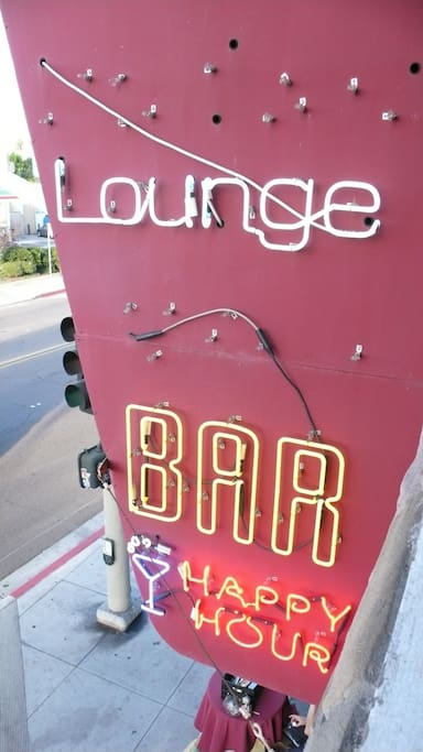 Your flat is above this classic neon and the T-Lounge and T-Deli.
