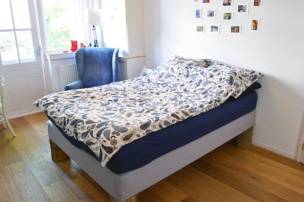 Very comfortable bed in this spacious bedroom