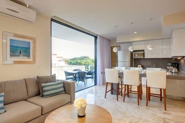 Living room, with balcony door open