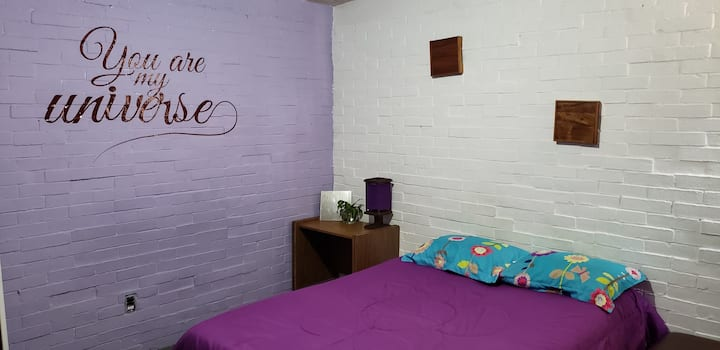 Private purple bedroom.