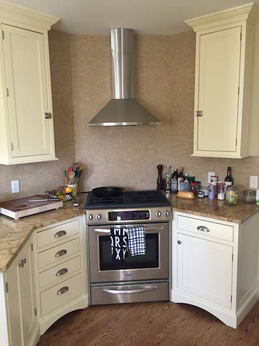 Recently updated kitchen with four-burner gas stove.