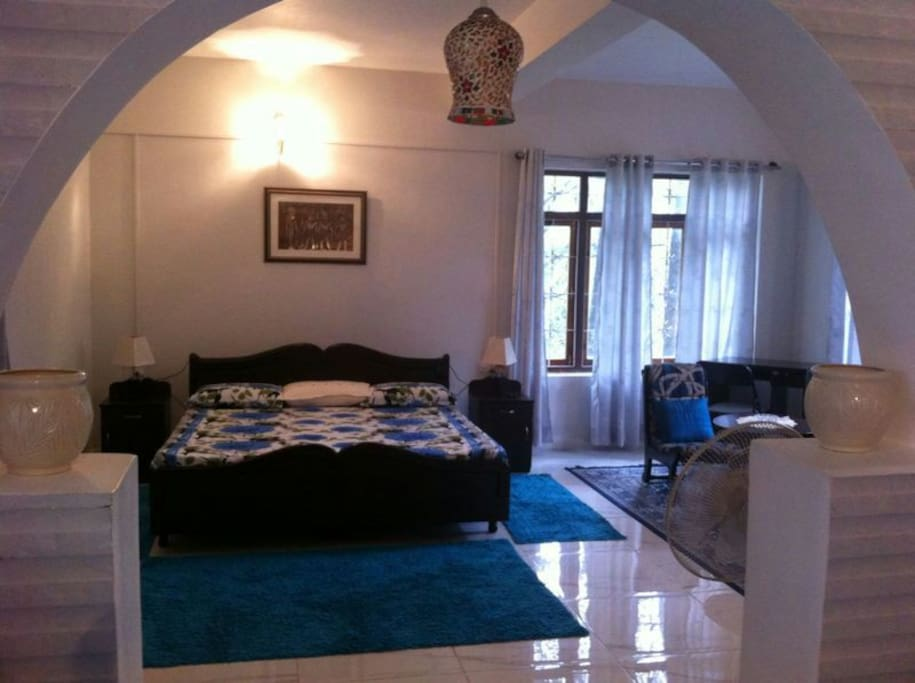 The interiors of the cottage with a bedroom, sitting area, fully equipped kitchen, private bath, balcony and terrace