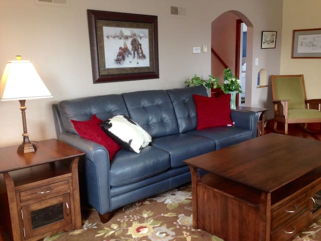 Comfortable living room. Amish made tables and Italian leather couch.
