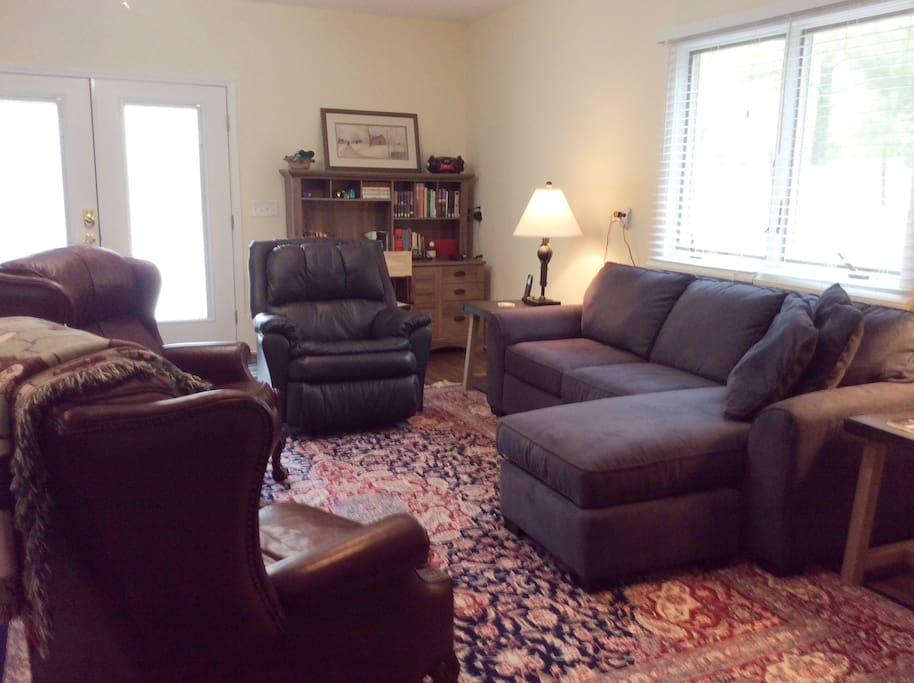 Living room with sofa and three recliners