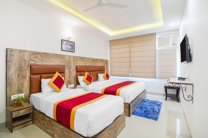 Triple Bed Room provided necessary facilities like One Queen size bed and One single bed, attached washroom, flat 32inch Tv screen, Air-conditioning, fan, carpeted Tile, Wardrobe/Closet, Free Toiletries, Trash cans, free Wi-Fi amd attched wash room.