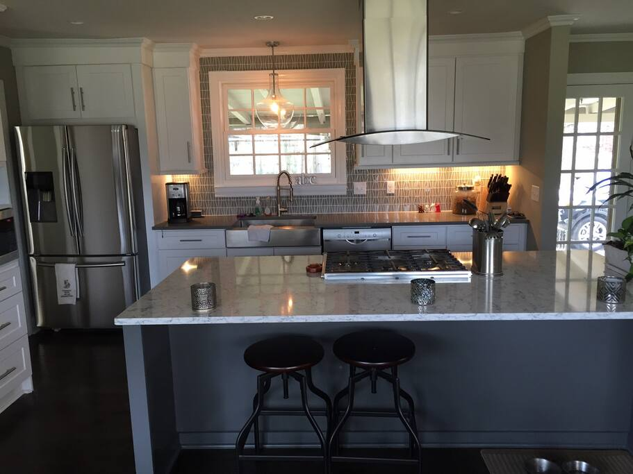 Dream kitchen with massive island, breakfast area and high-end appliances.