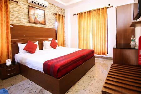 This twin room features a balcony, seating area and tile/marble floor.