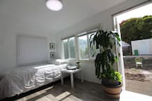 Remote controlled LED light. The front door goes straight to the backyard... enjoy the sun.
