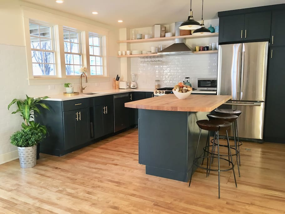 Brand new chefs kitchen with quartz countertops and a large island to make cooking for 8 a breeze!