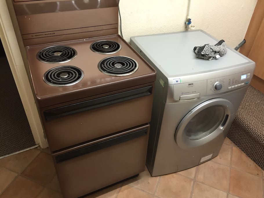 Oven and stove, microwave, kettle, washing machine, tumble dryer, sink and access to all our pans.