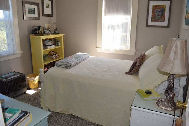 First floor bedroom with double bed and private bath two steps away.