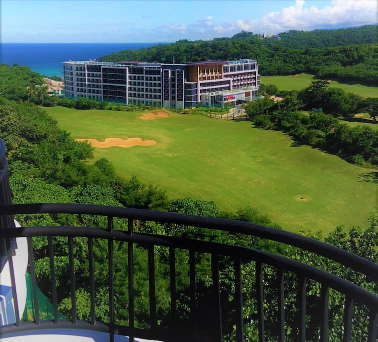 View of Savoy hotel, golf course and sea from private balcony