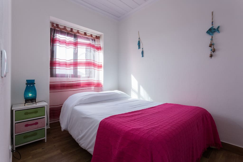 Pink room with standard double bed