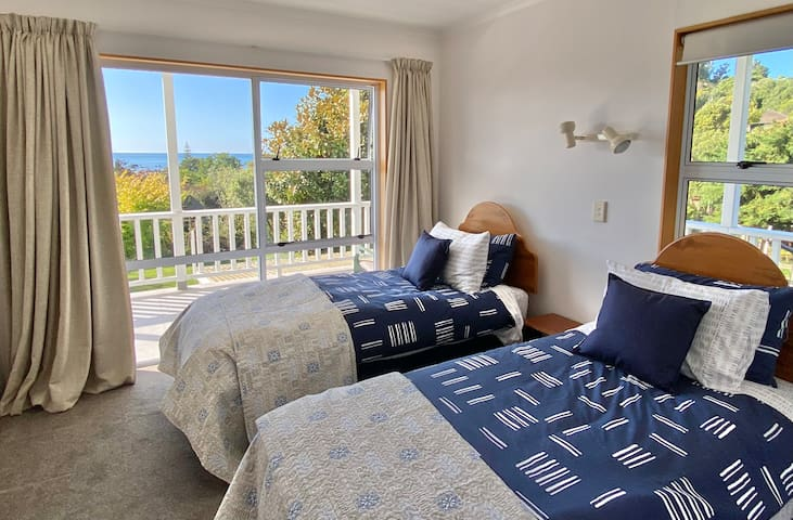 Bedroom 3 , 2 single beds , also has the ranch slider opening onto the veranda. Windows the 2 sides making it a lovely warm room with a great view to the sea. Has a large wardrobe.