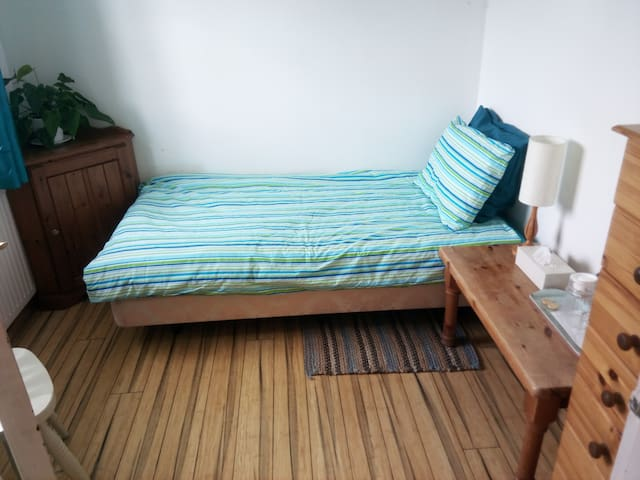 Comfortable bed in cosy room
