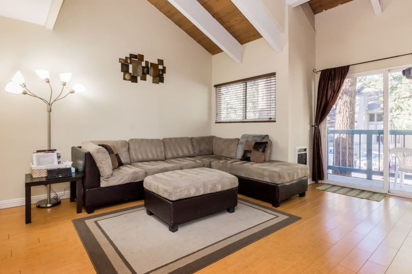 Living room with Flat screen TV, private patio access, and studio kitchen