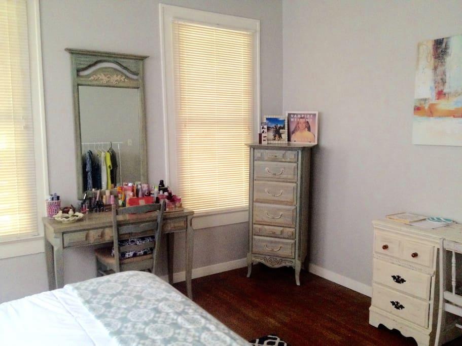 Natural lighting, vanity, and storage space