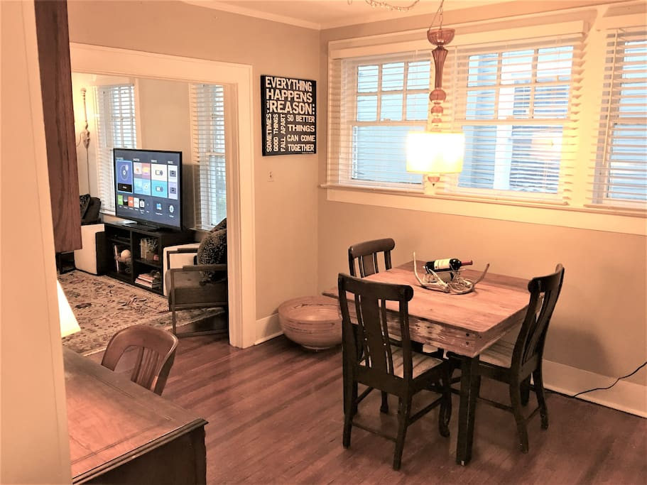 Dining area for four w/ a complementary bottle of wine.