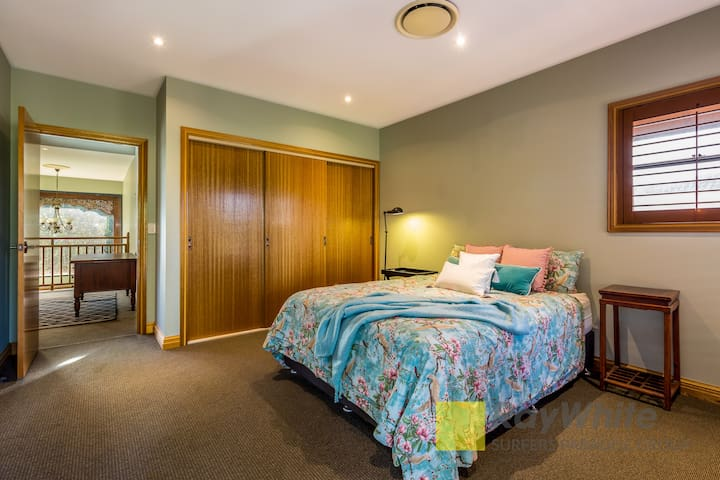 Queen bedroom. Opens on to large balcony with stunning golf course views.