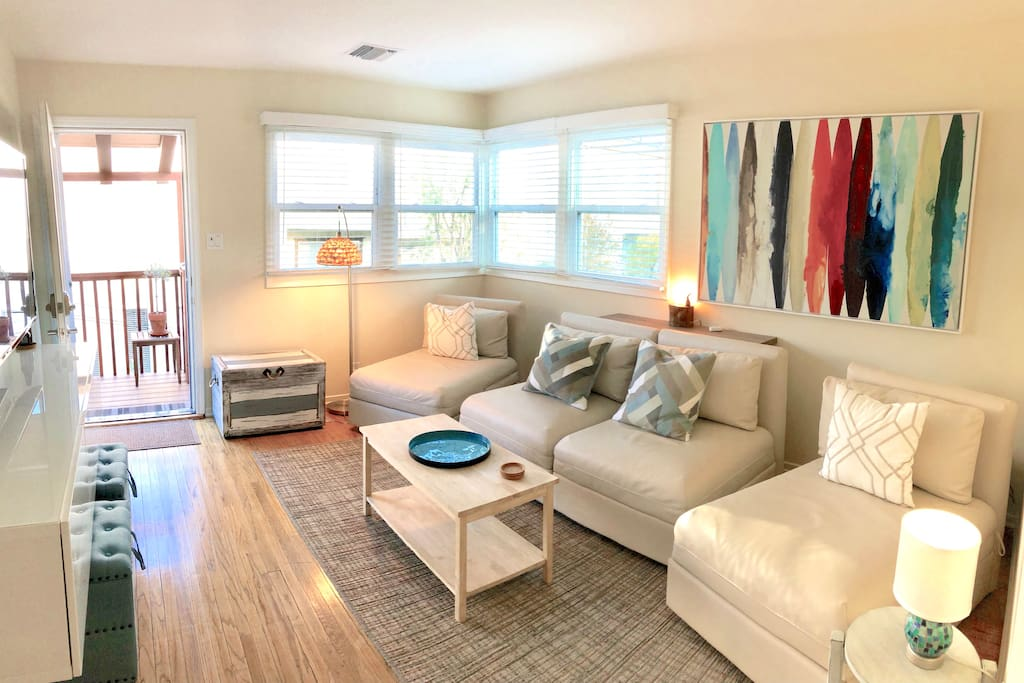 Bright and airy, but cozy, front room for relaxing, hanging out and watching tv.