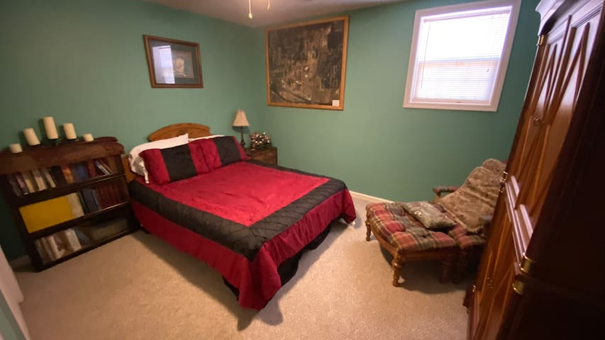 Bedroom at end of hall in basement.