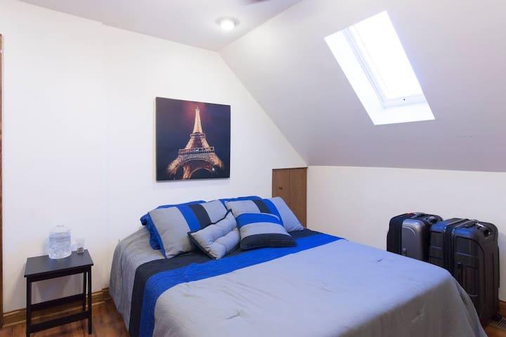 Shared Sun Room: Little Village, Bed 1 (Queen)