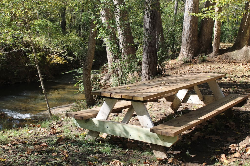 Outdoor picnic area by stream