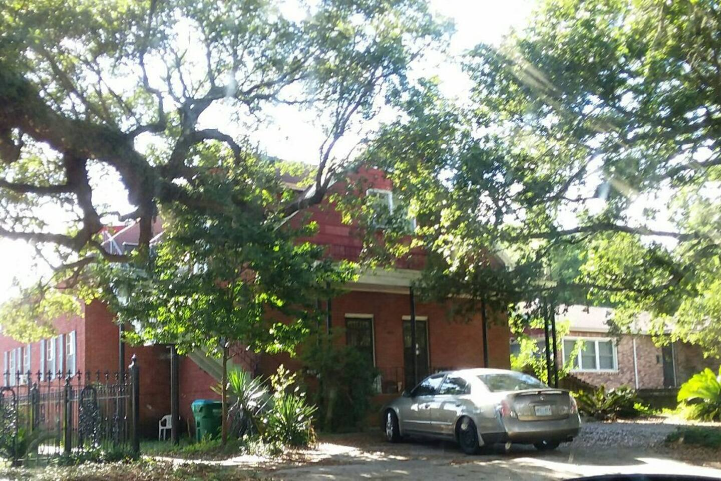 THE MAIN HOUSE is a Two story, red brick house over 100 years old.  The huge oak is over 320 years old.  The Beach Balcony Suite is at the top of the staircase-A nice porch as you enter the foyer.  The neighborhood is old-& two blocks from the beach.
