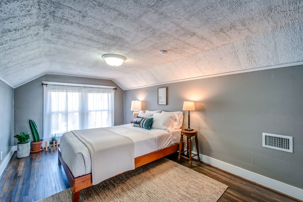 "Bedroom 1 with a comfy queen-size bed // ""Definitely would rent this Airbnb again. Great location on the east side of Nashville. Very clean, well stocked kitchen, lots of towels and blankets. Couldn't have asked for anything more!"" -Jeff ★★★★★"