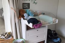 Changing table for babies in the room with the sofabed