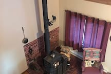 view of wood stove and setting area