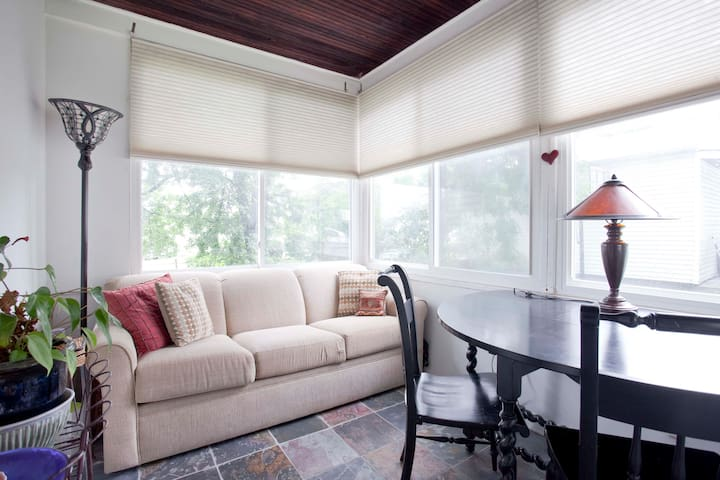 Use the sunroom for a relaxing cup of coffee or your WiFi connected workspace
