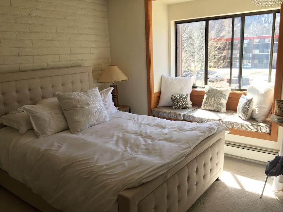 Master Bedroom with tons of light and nook for reading/relaxing. High end new bed and bedding.