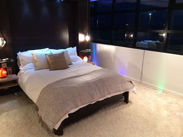 master bedroom by night with cool led lighting and calming himalayan salt lamps