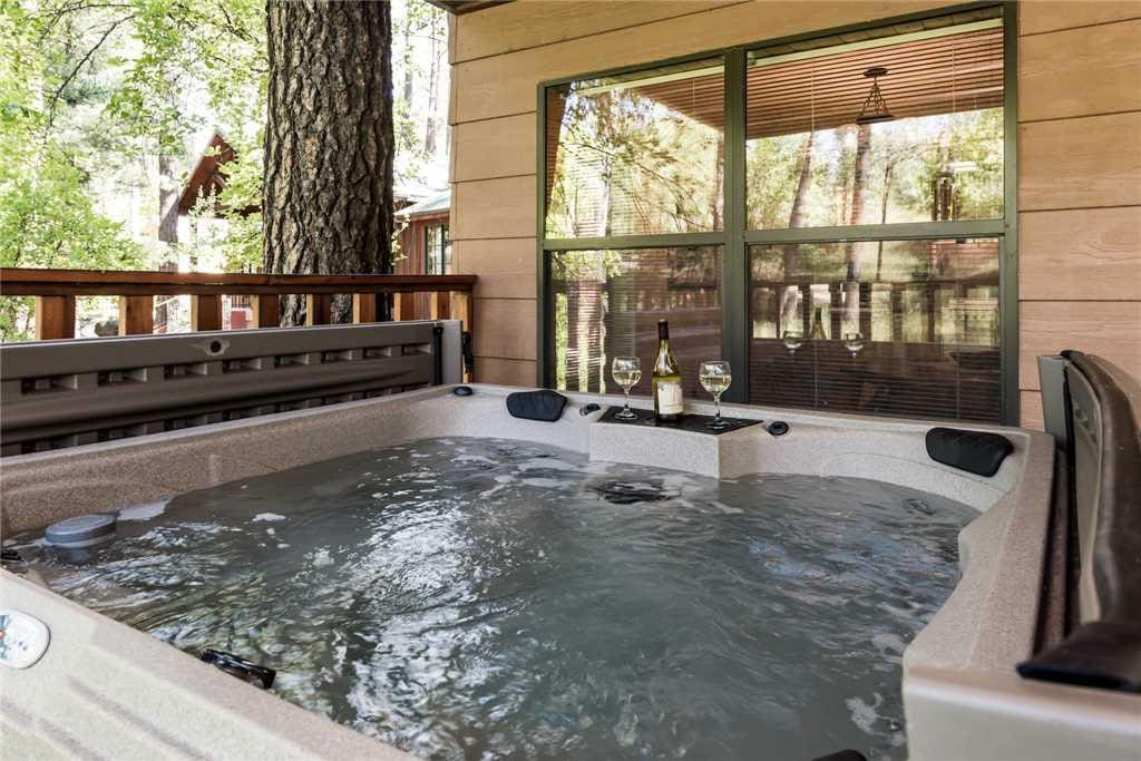 Soothing Waters - Imagine ending each day in the hot tub while you celebrate another perfect day on your vacation. After a long e