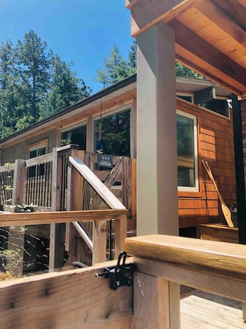 Looking at Treehouse Cottage coming up the last of many steps from our private dock