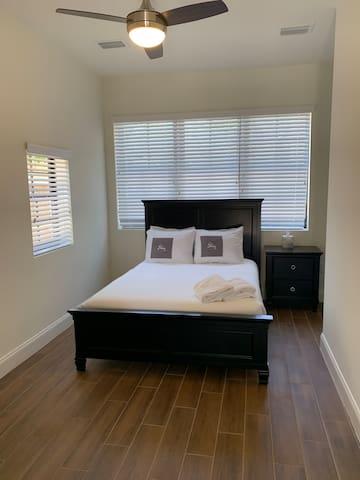 Bedroom 4. Full Bed en suite Lower Split Level Bedside Table & Lamp with USB & Electrical Outlets  Hangers/Closet