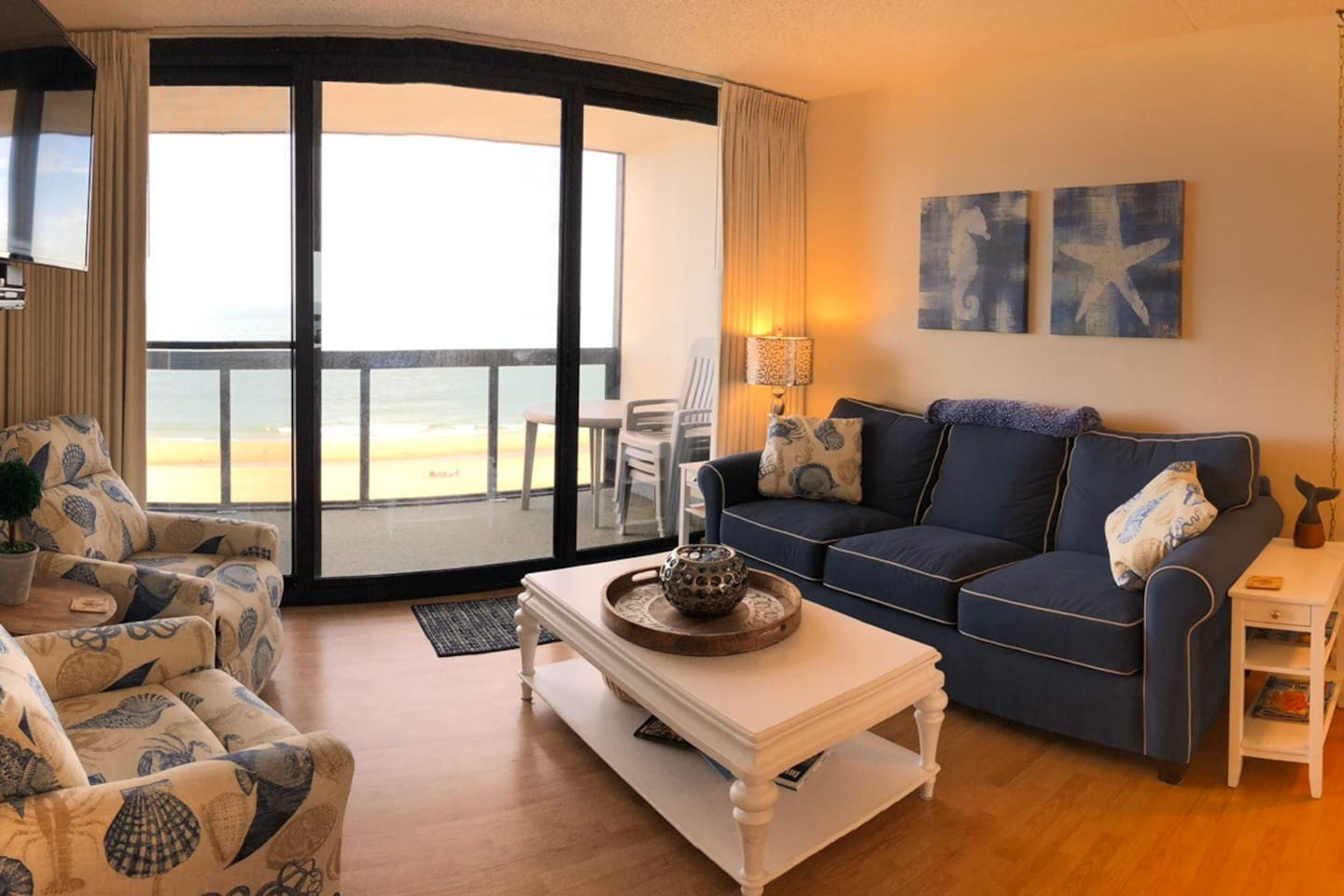 Cozy, stylish living room with gorgeous oceanfront view through floor to ceiling windows!